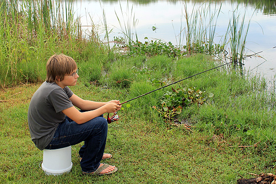 Trey fishing on a bucket 1 560