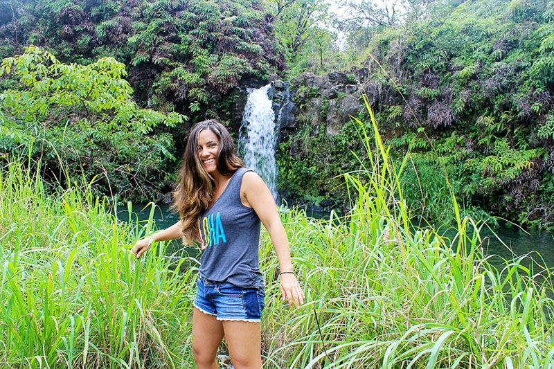 Nell Laughing in Front of Waterfall