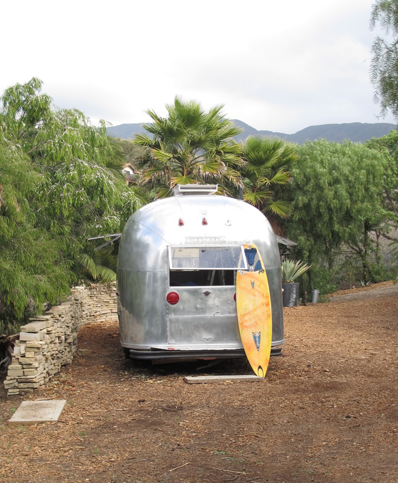Airstream with Surfboard