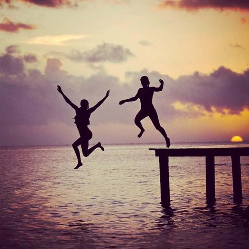 Jumping off Pier at Sunset