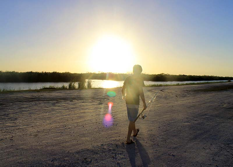 Walking into Sunset with Fishing Pole