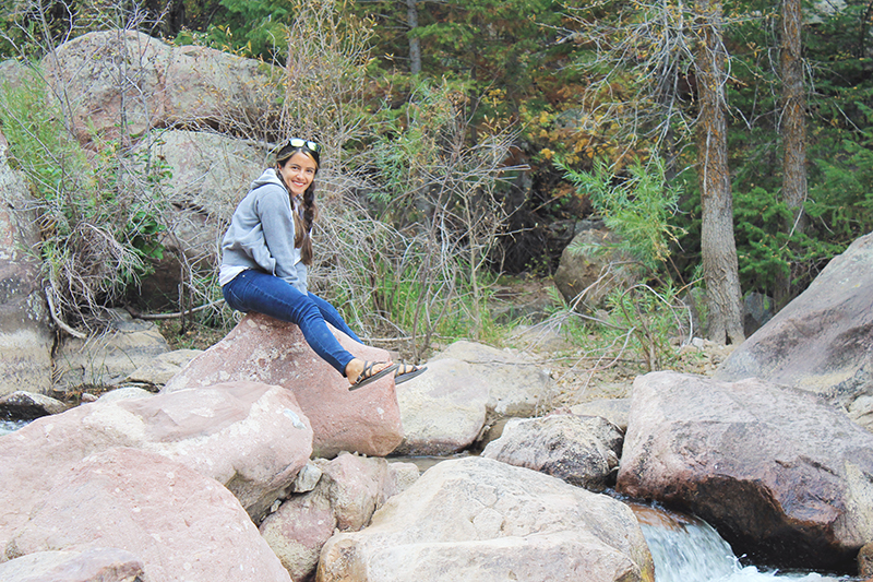 Nell Sitting on Rock at Creek