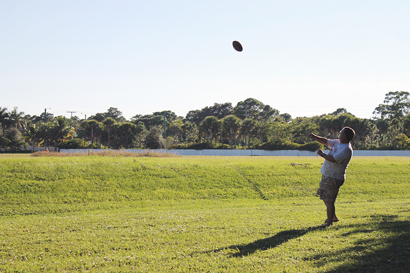 Papa throwing football