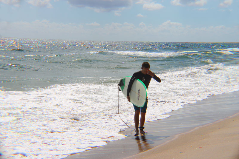 Trey Walking in from Surfing