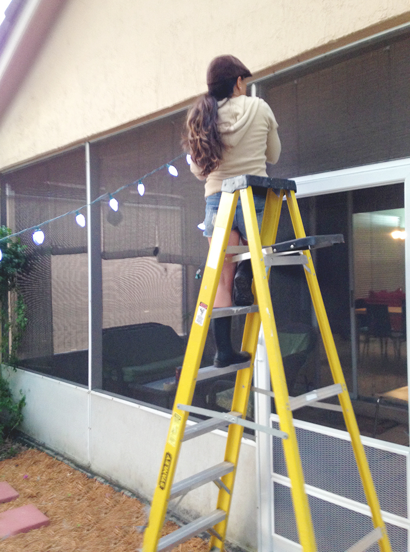 Hanging Lights on Ladder at House