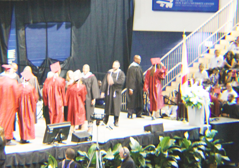 Dee Walking Across Stage