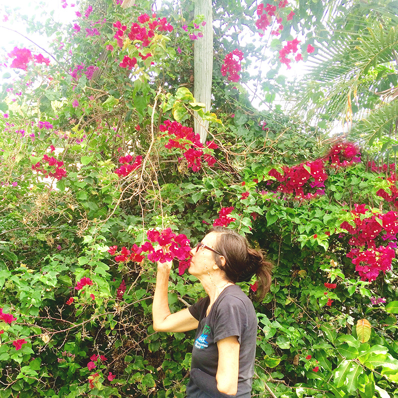 mom smelling roses