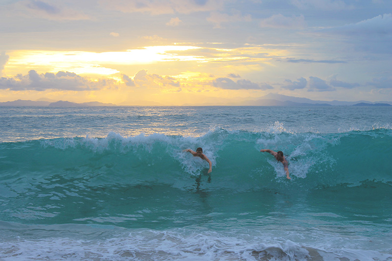 Steve and Trey Catch Wave Sunset