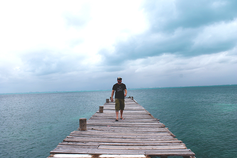 Steve Walking down wavy Pier Front 2 Small