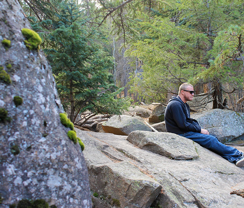 steve-sitting-on-rock-small